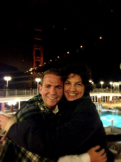 Ross and a friend bundle up for the nighttime sail out of San Francisco