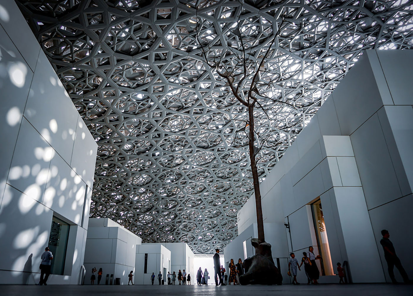 The interior of Louvre Abu Dhabi, showcasing its signature ceiling
