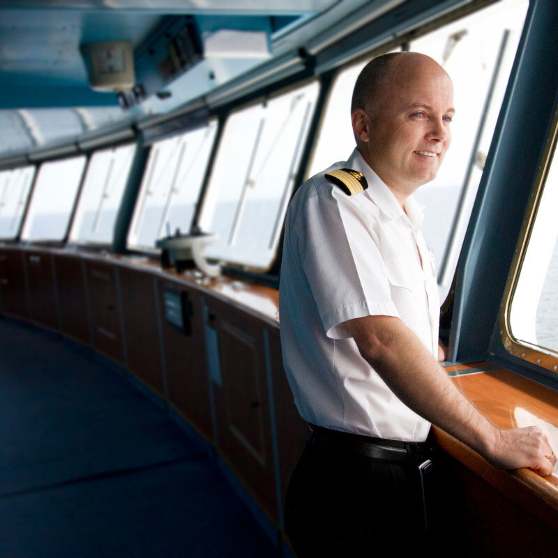 Captain Johannes looks out the window