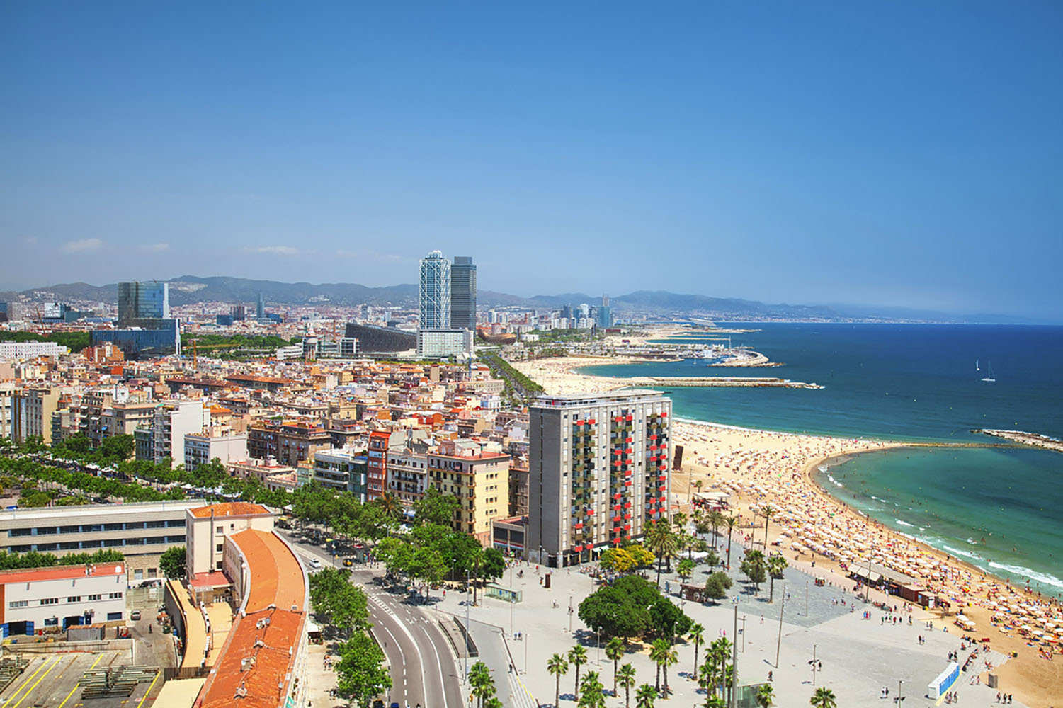 For a real urban beach experience, visit Barceloneta Beach in Barcelona.