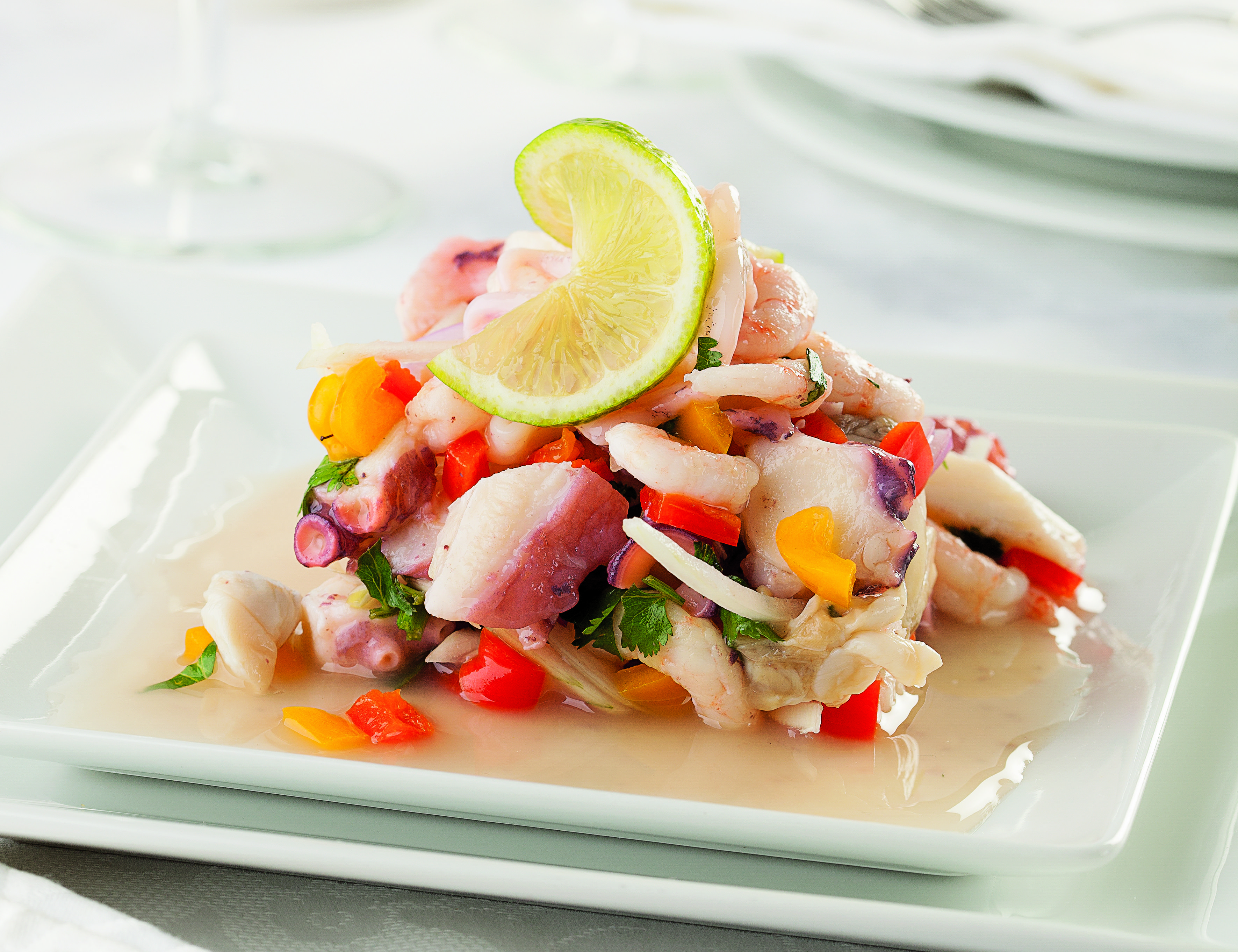 A colorful plate of ceviche, a beloved Peruvian dish
