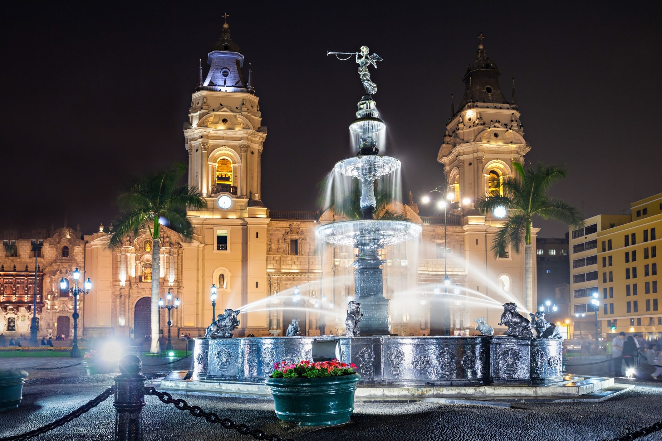 A fountain in Lima, Peru illuminated on a beautiful evening