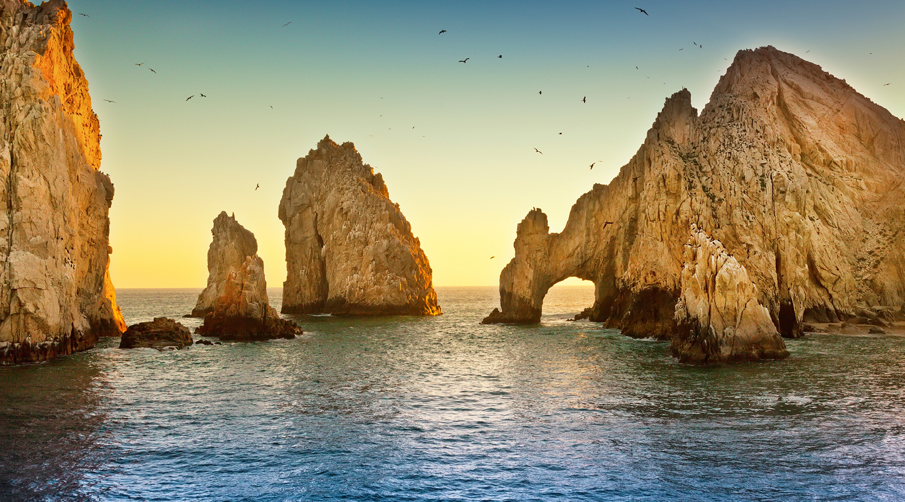 The El Arco rock formation in Cabo San Lucas at sunset.