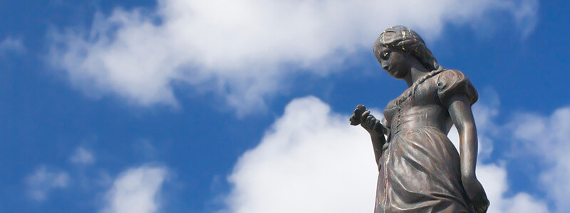 woman statue under cloudy blue sky