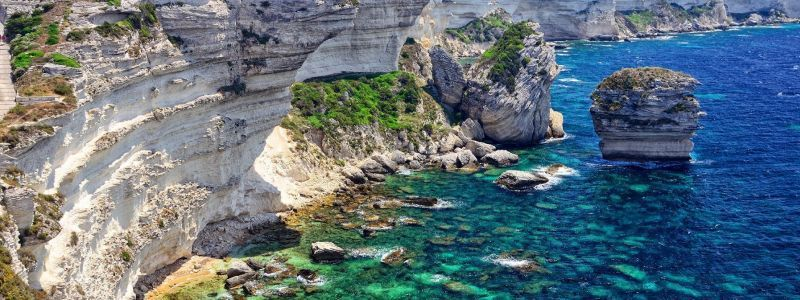 crystal blue water surrounded by cliffs in bonifacio corsica