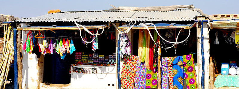 Colorful clothing on display at Craft Market of Benfica in Luanda, Angola