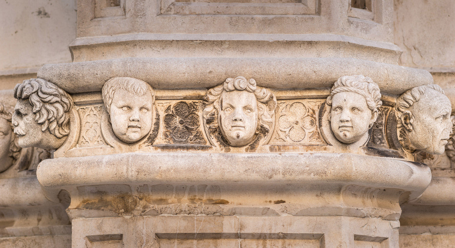 Stone faces on the exterior wall of the St. James Cathedral in Sibenik, Croatia.