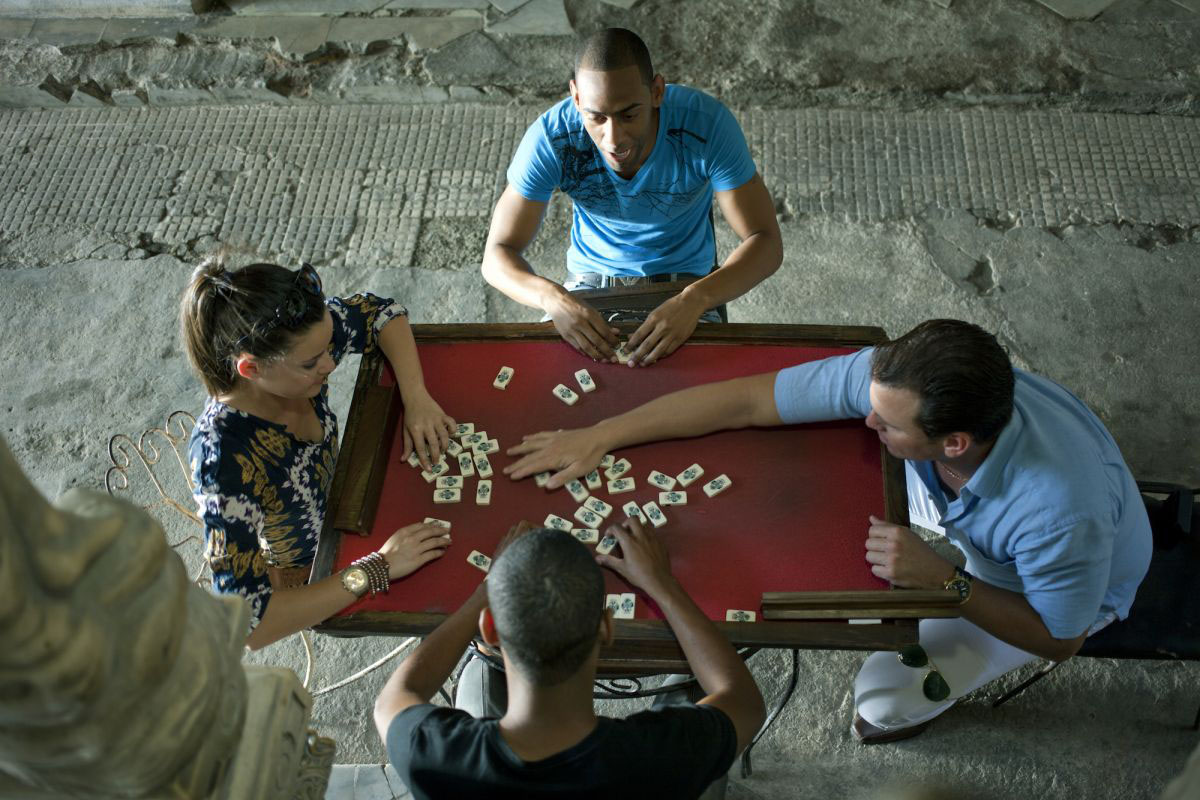 A group of Cubans playing Dominoes