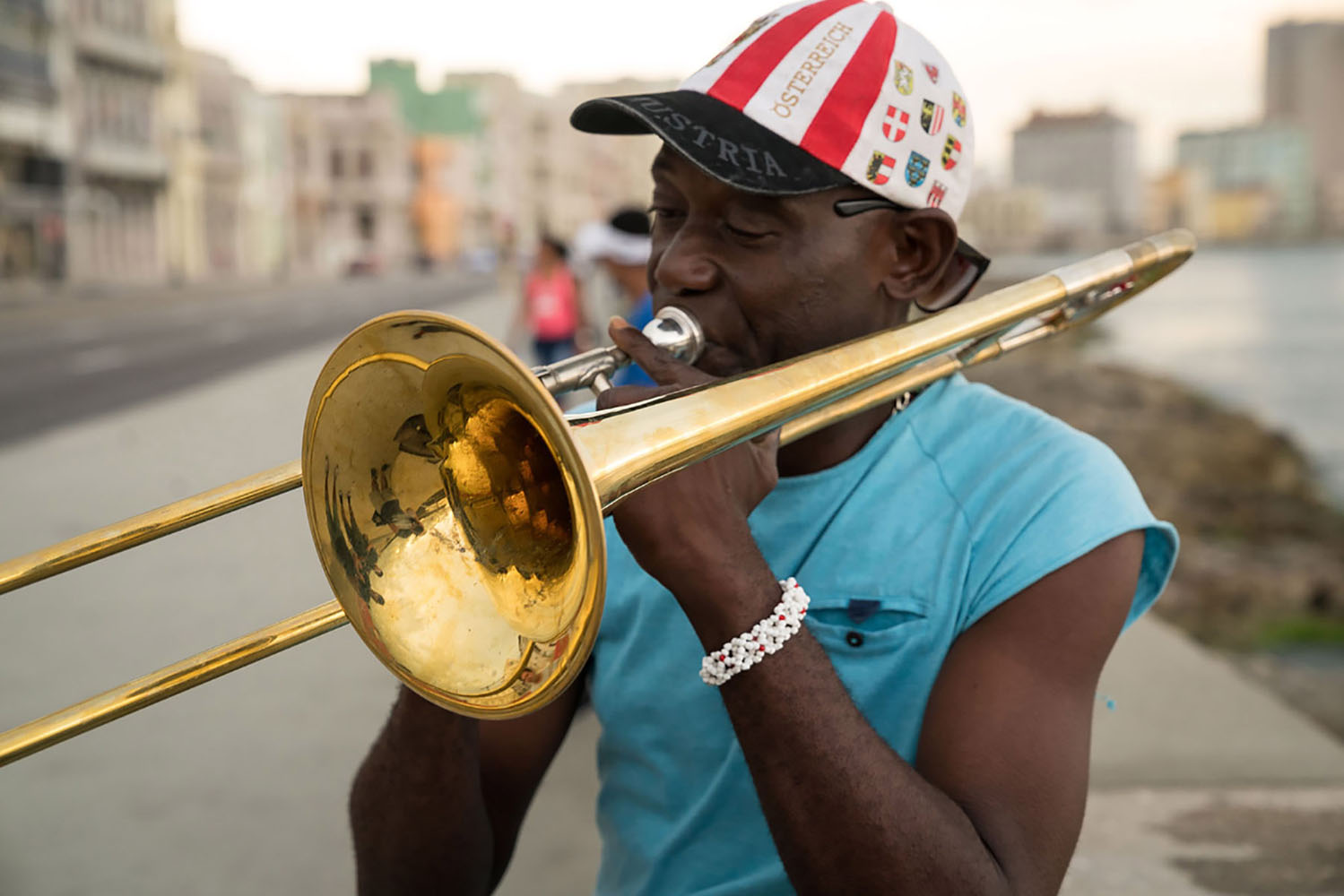 A man playing Cuban music on a trombone