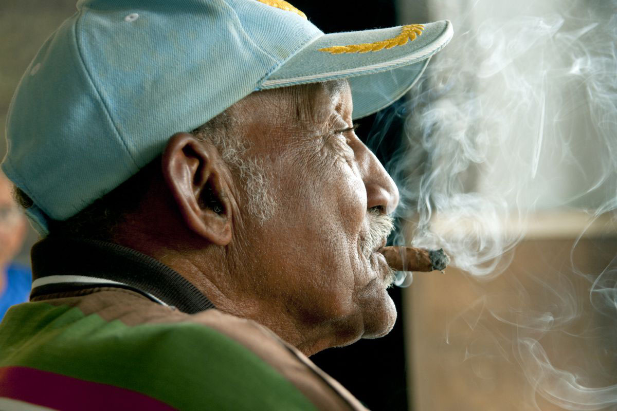 A Cuban man smoking a cigar