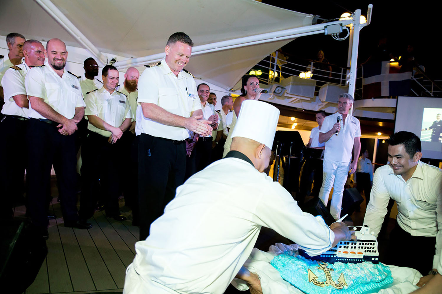 Cutting a cake in Captain Carl's honor onboard the Azamara Quest cruise ship.