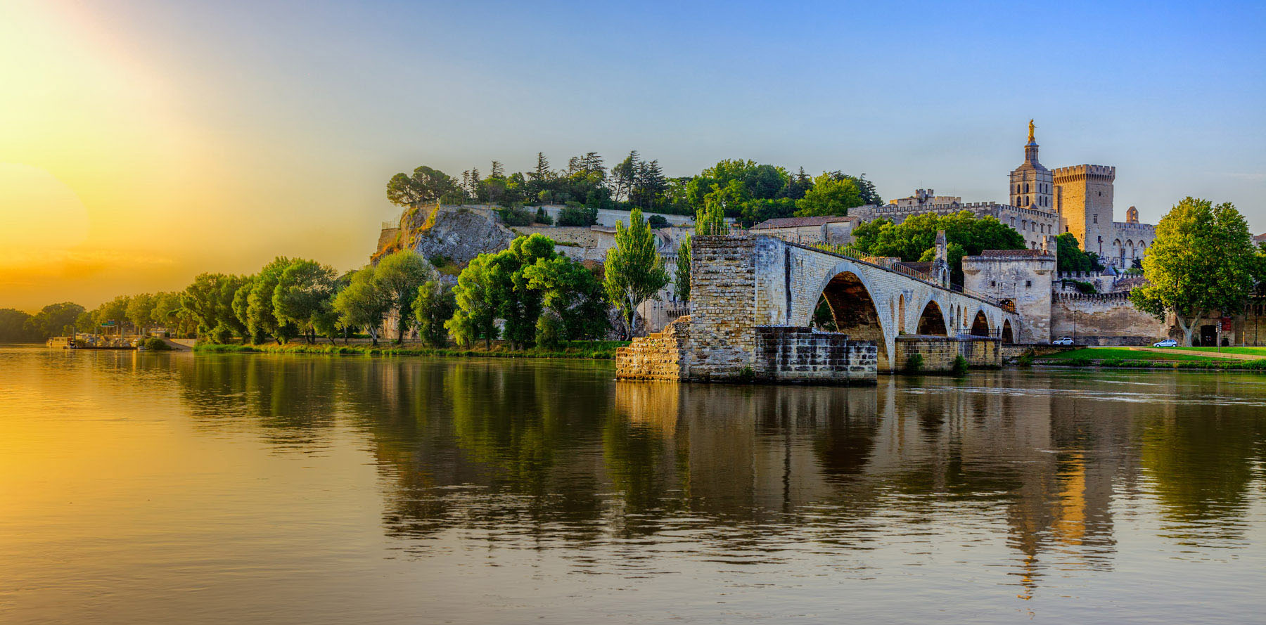 A view of the Avignon Bridge and Popes Palace in Pont Saint-Benezet, Provence, France