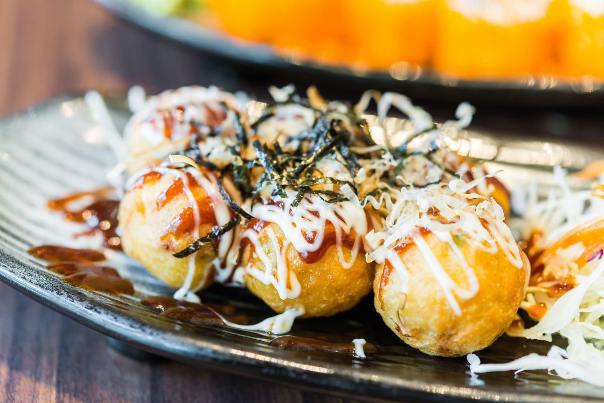 Takoyaki, savory balls of batter, filled with octopus