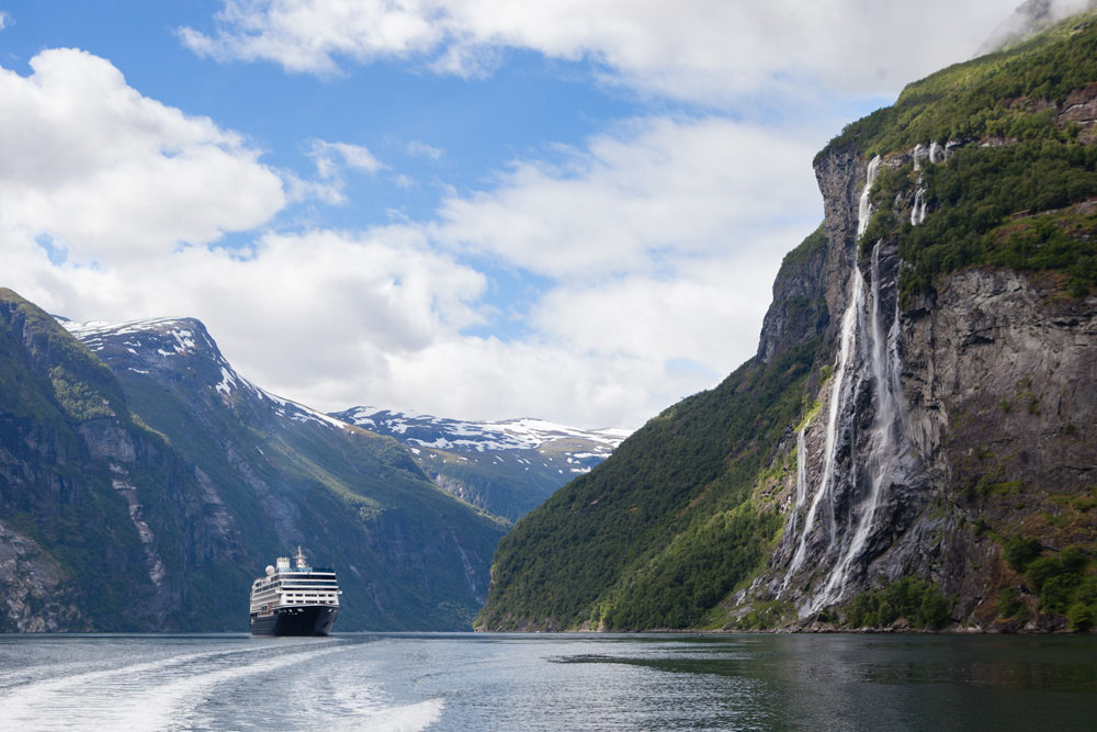 The Azmaara Quest cruises past waterfalls in Norway.