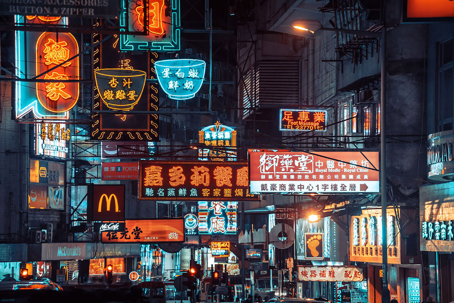 Colorful neon signs light up a street in Hong kong