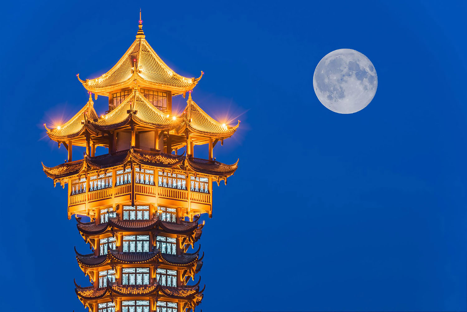 Chinese traditional tower illuminated at night