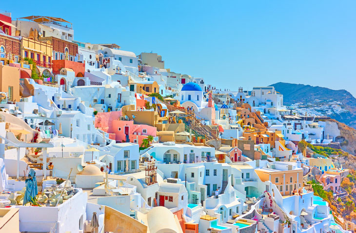 Panoramia of colorful buildings in Oia, Santorini