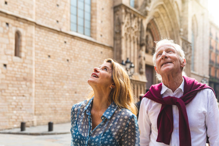 A senior couple visits Old Town in Barcelona