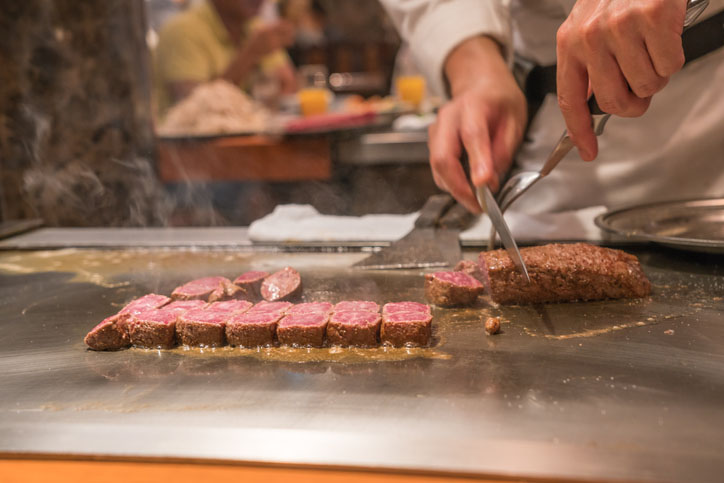Chef cooking wagyu beef in Japanese restaurant