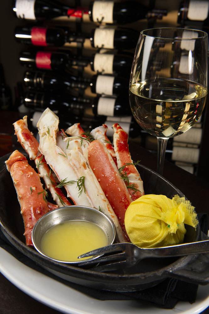 Alaskan King Crab Legs with Lemon and Butter served with white wine