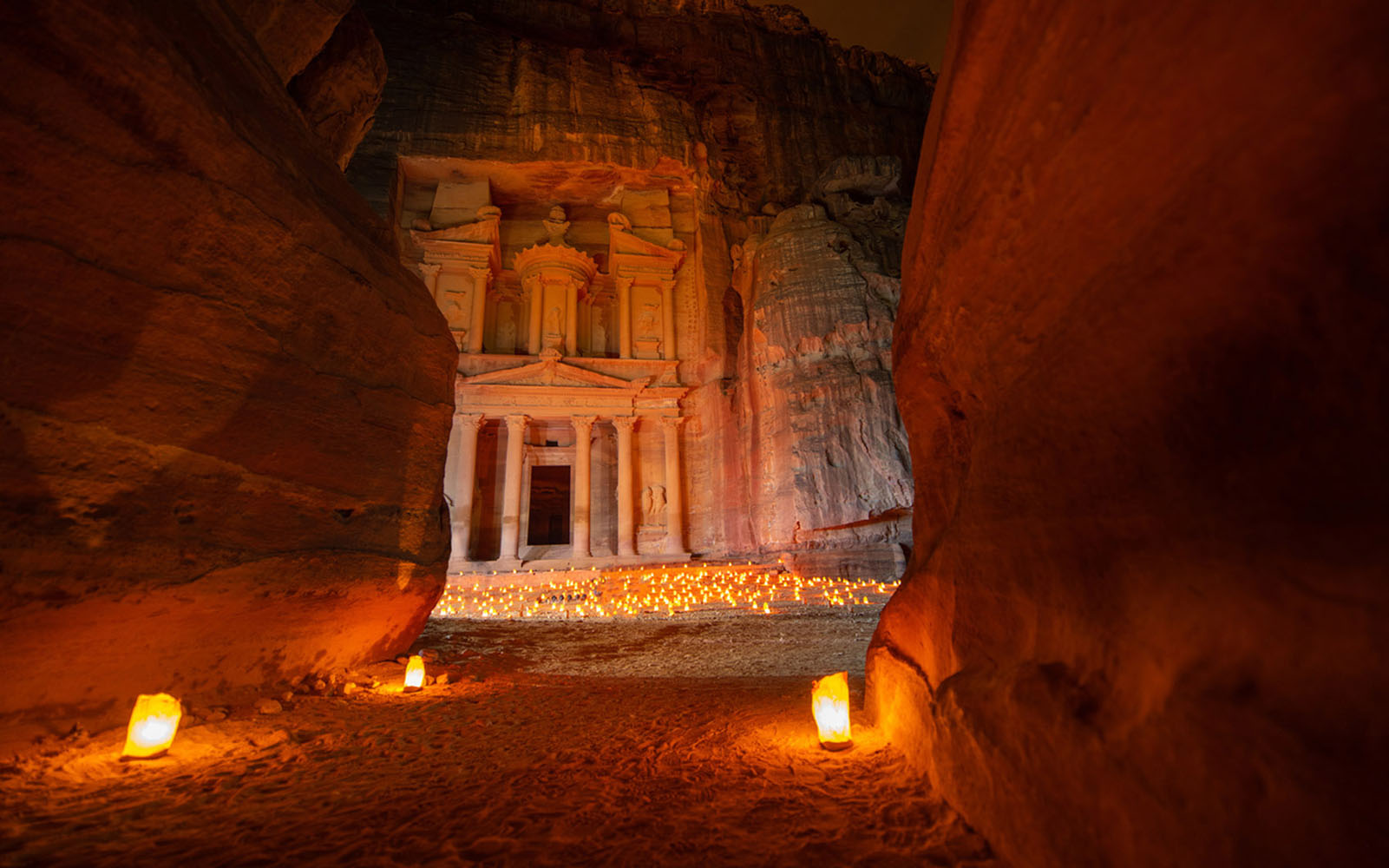The ancient city of Petra lit by candles in the evening.