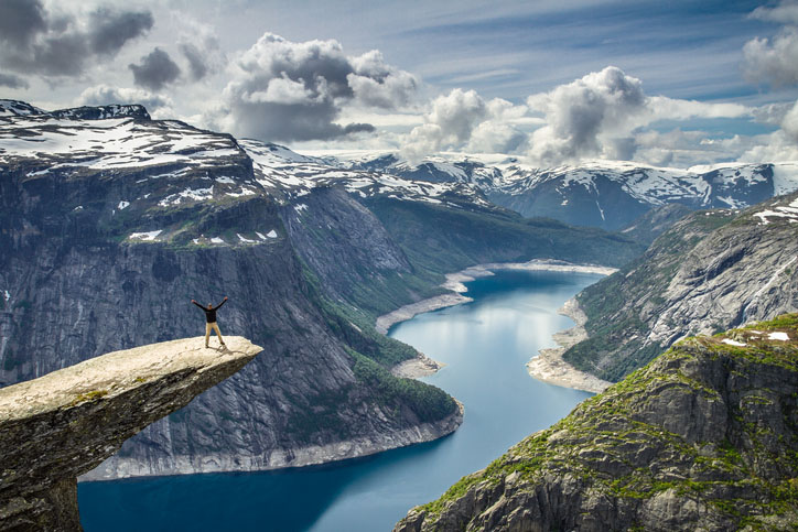 A man stands at Trolltunga in Norway