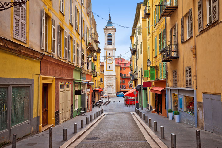 Colorful street architecture and church view in Nice, France
