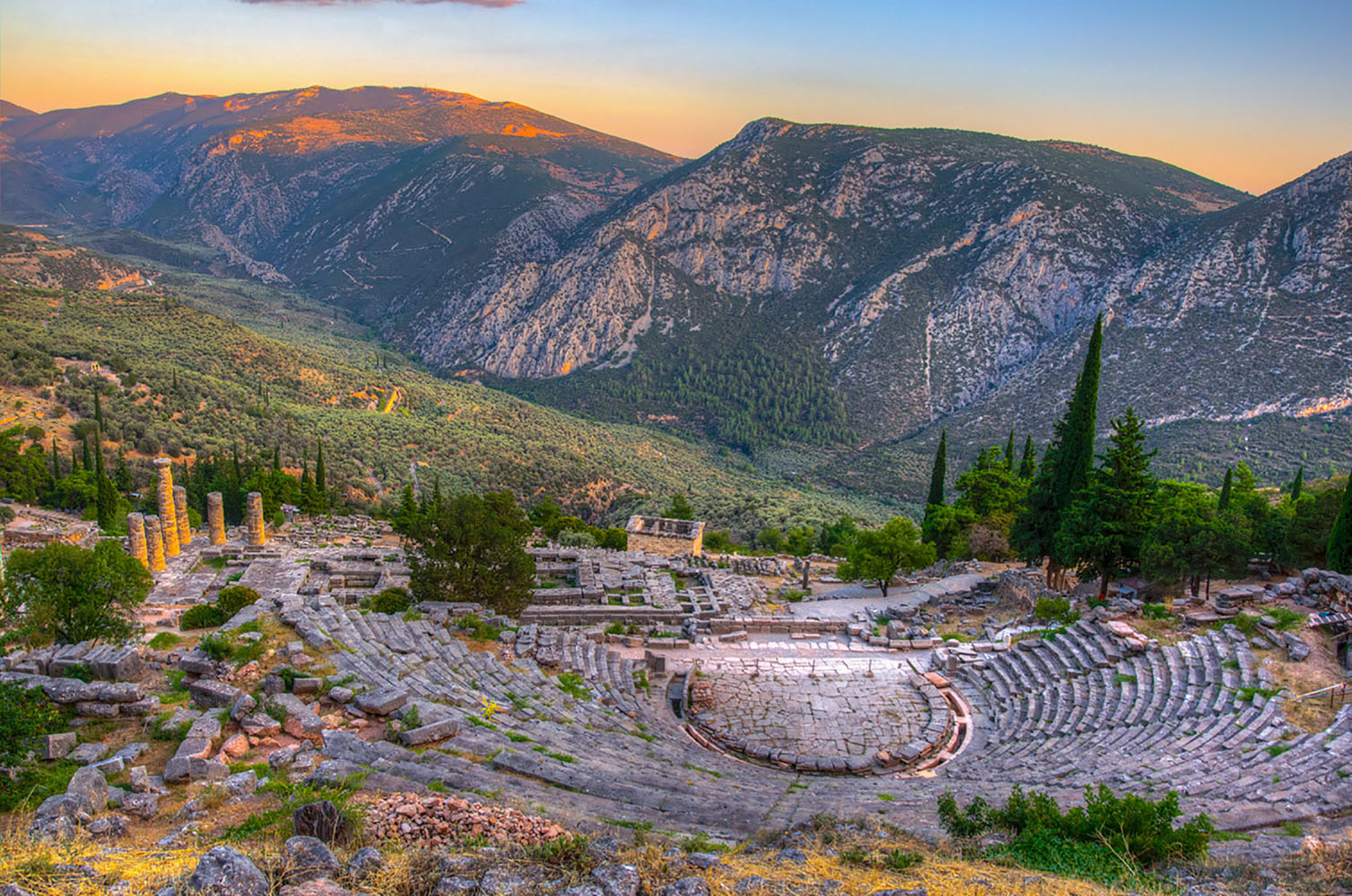 The ruins of a theatre in ancient Delphi, Greece at sunset
