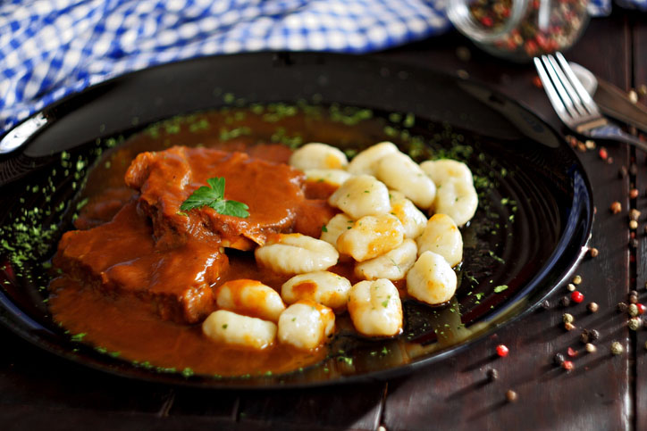 Pasticada with gnocchi, beef stew in a sauce