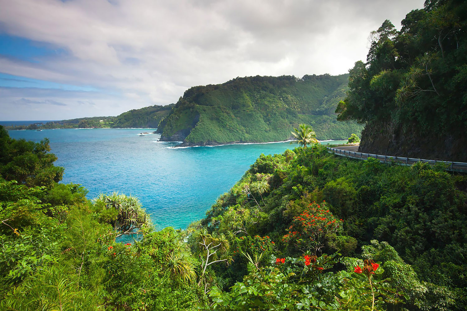 "A road known as ""The Road to Hana"" makes its way along the shore in Maui, Hawaii"