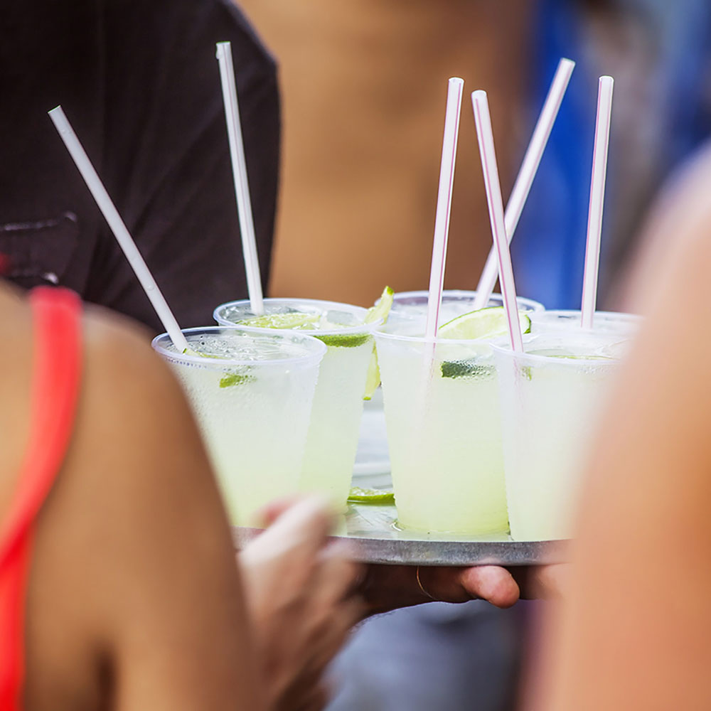 Attendees of Rio's Carnival are served cocktails.