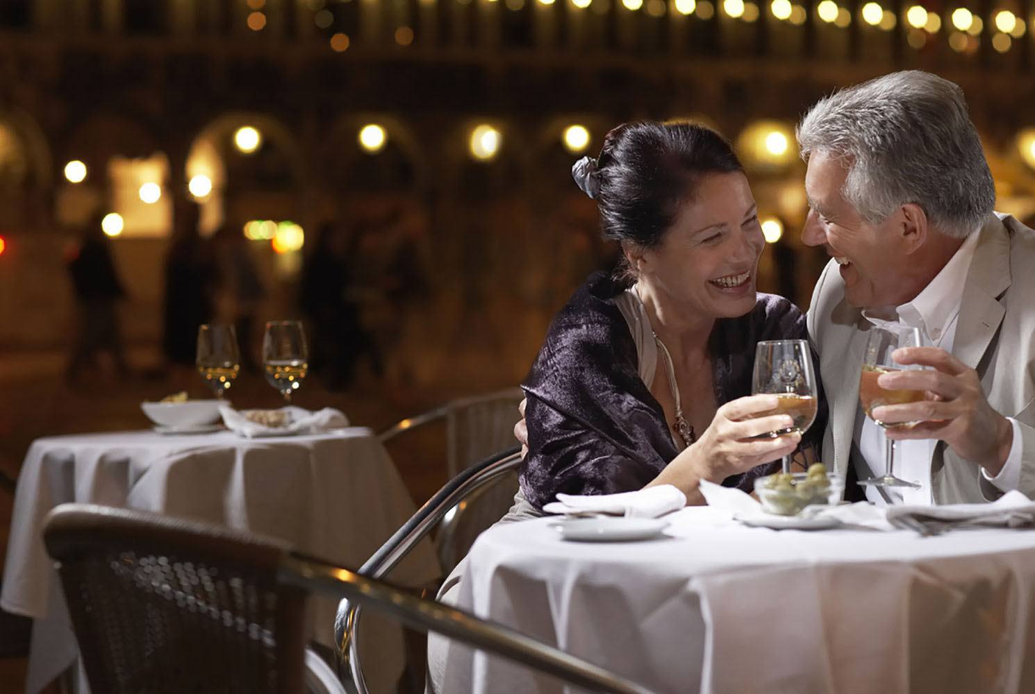 A couple at restaurant table at night in Venice