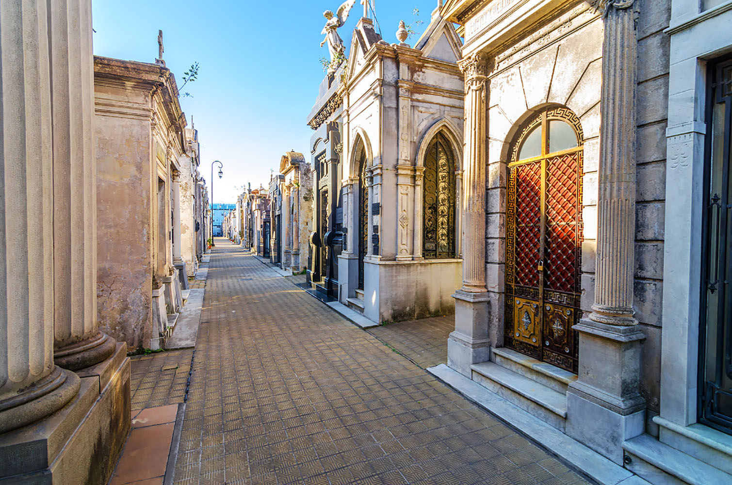 The narrow laneways of Recoleta Cemetery on a clear sunny day