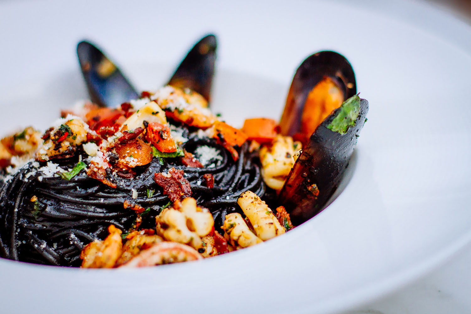 Squid ink pasta with seafood.