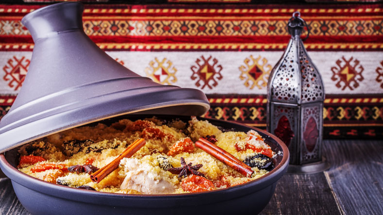 Traditional moroccan tagine of chicken with dried fruits and spices