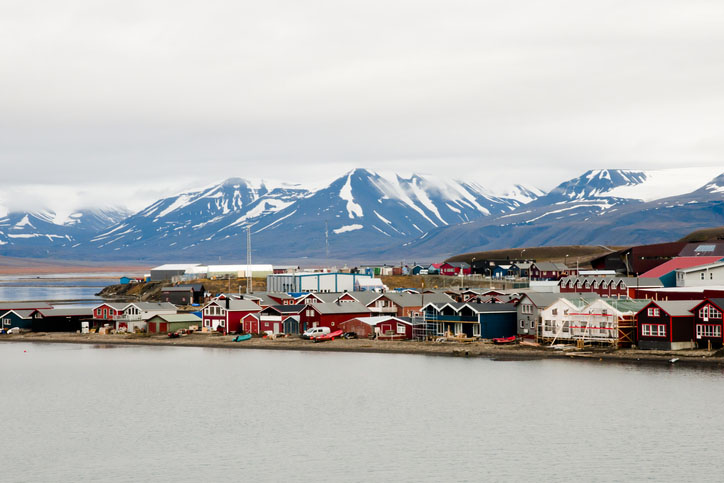 Longyearbyen with snow-capped mountains in the background