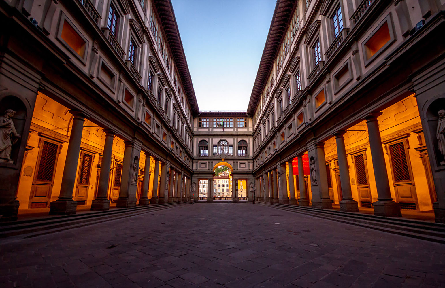 The Uffizi Gallery in Florence is illuminated at night.
