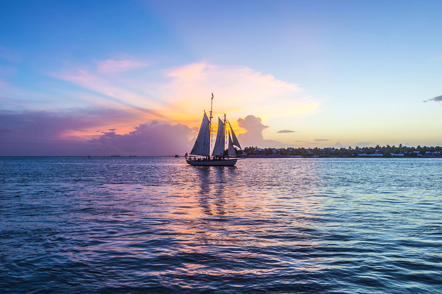 Sunset at Key West with a sail boat on the water