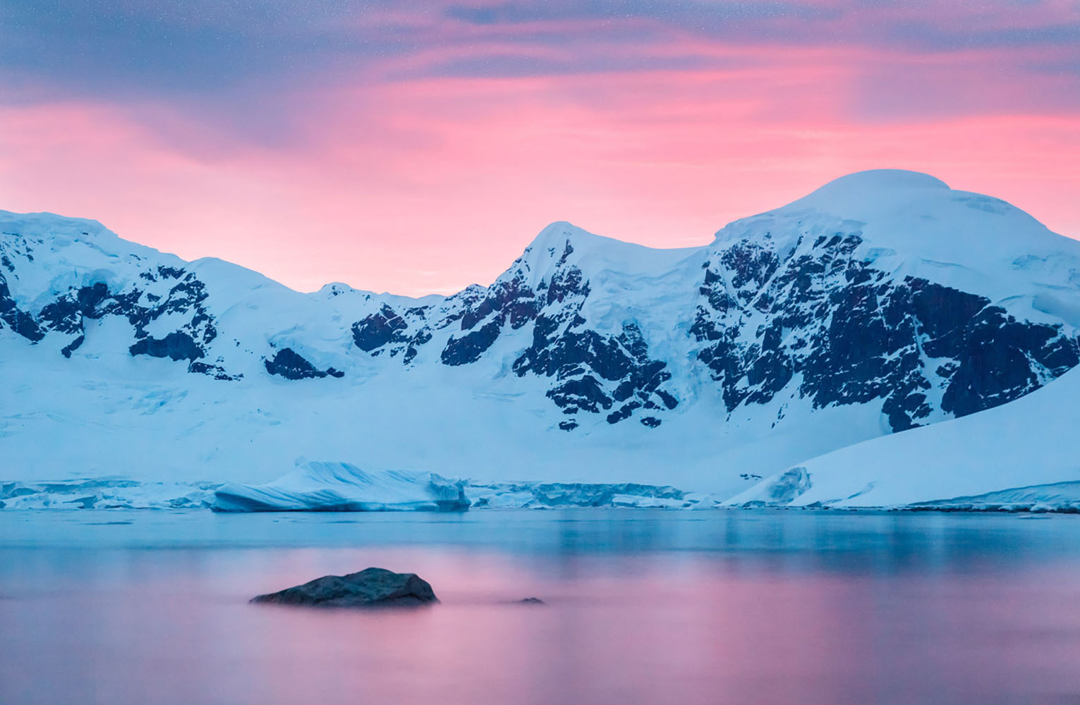 A bright pink sunset in Antarctica.