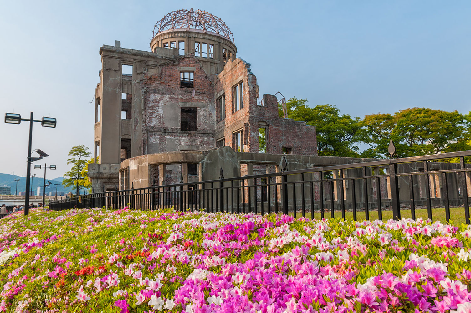 The Hiroshima Peace Memorial with flowers in the foreground