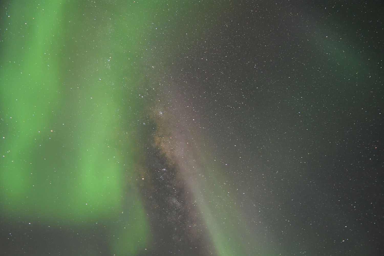 The Southern Lights, or Aurora Australis, in Antarctica. Seen with the Milky Way.