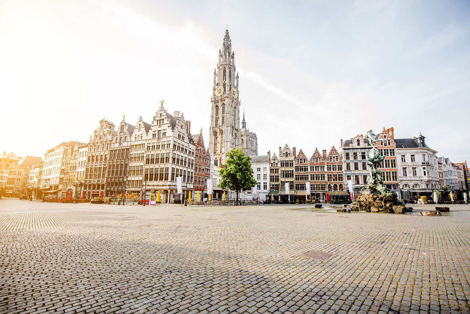 Historic buildings and a church tower in Antwerp, Belgium.