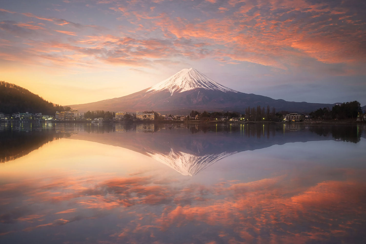 Fuji mountain reflection on water at sunrise near kawaguchiko lake, Japan