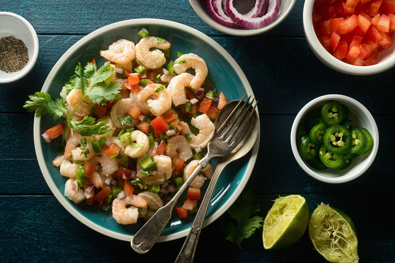 Shrimp ceviche with tomato, red onion, Jalapeño pepper, cilantro and lime.