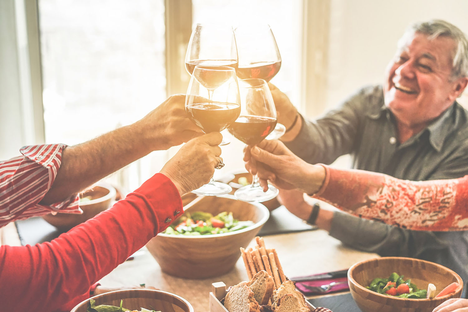 Friends toast with wine over dinner