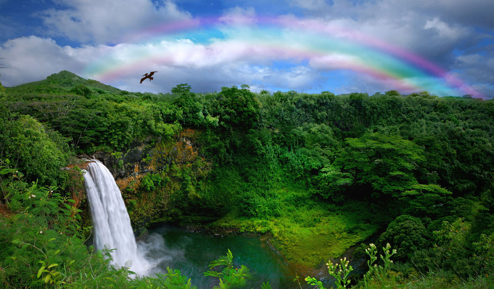 Waterfall With Rainbow in Kauai, Hawaii