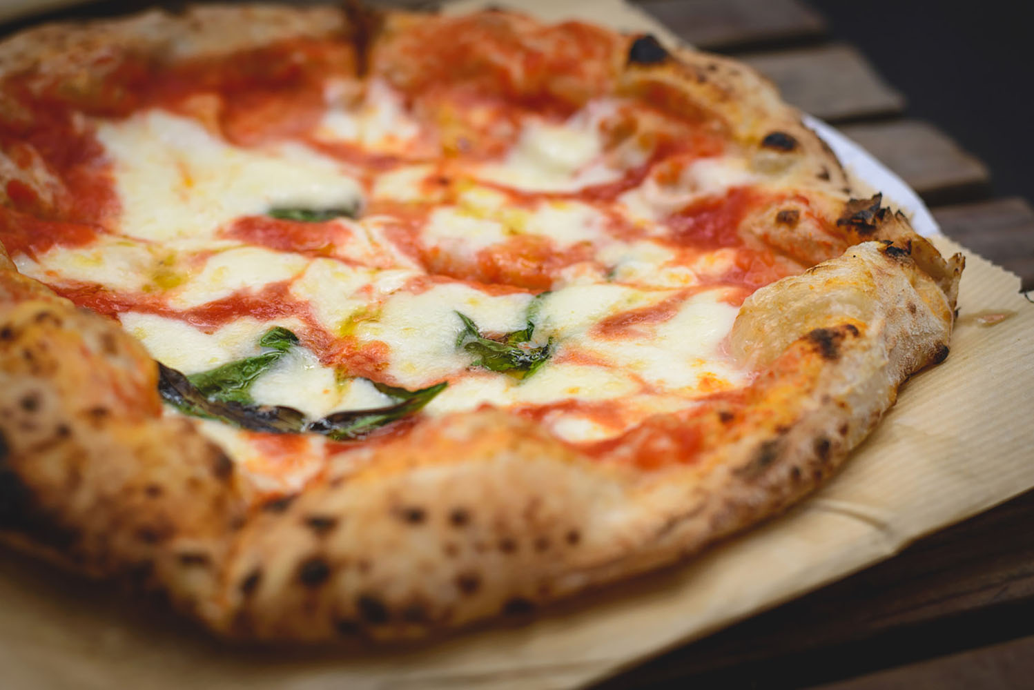 Margherita Neapolitan style pizza with buffalo mozzarella, tomato sauce and basil