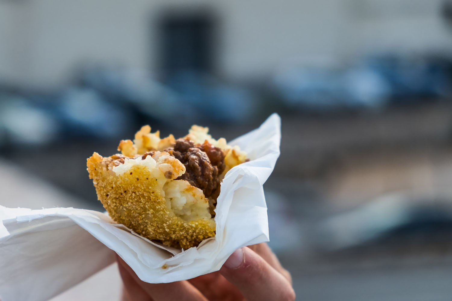 An arancino, the typical sicilian street food