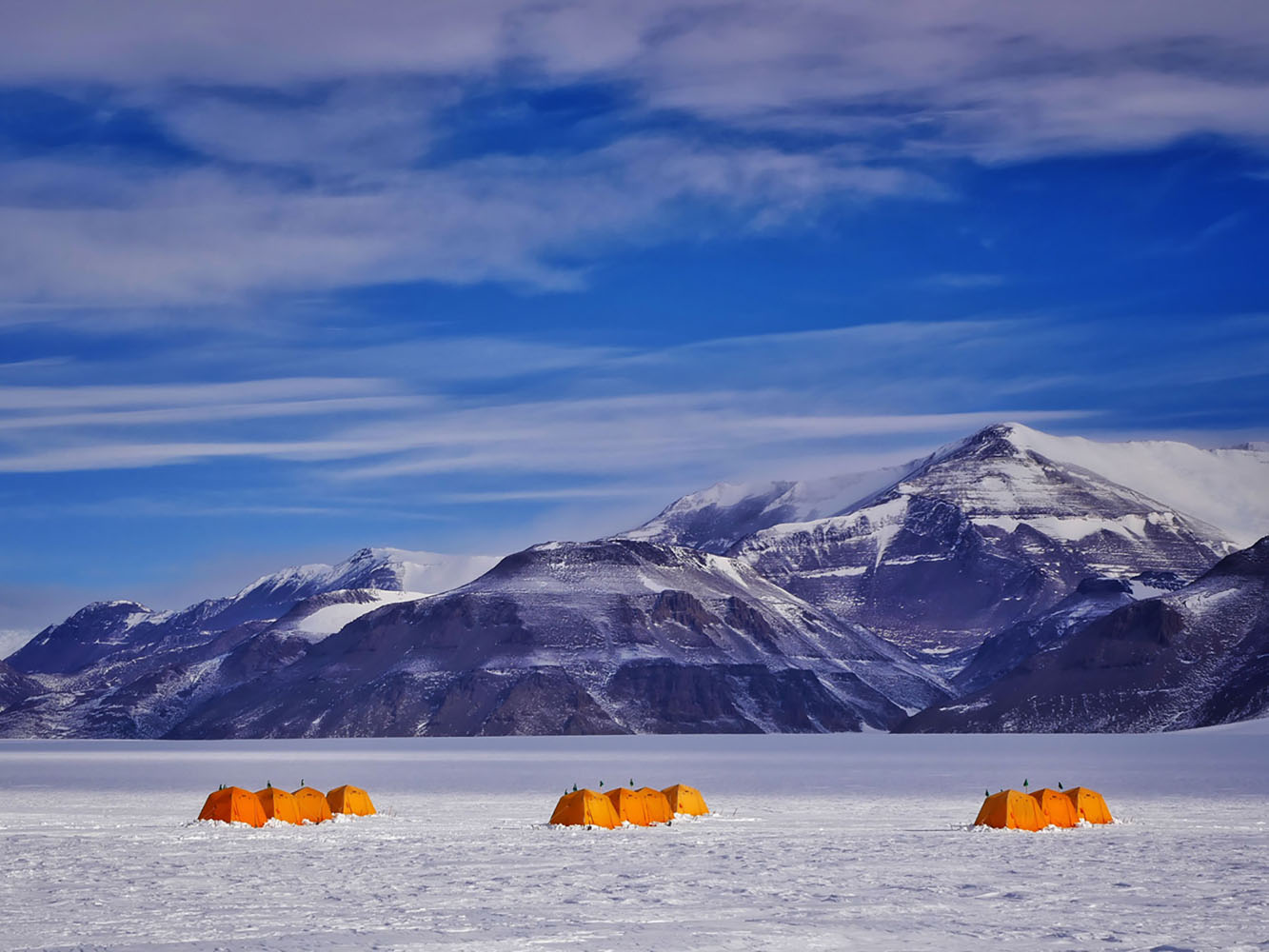 Orange tents that house scientists in Antarctica.