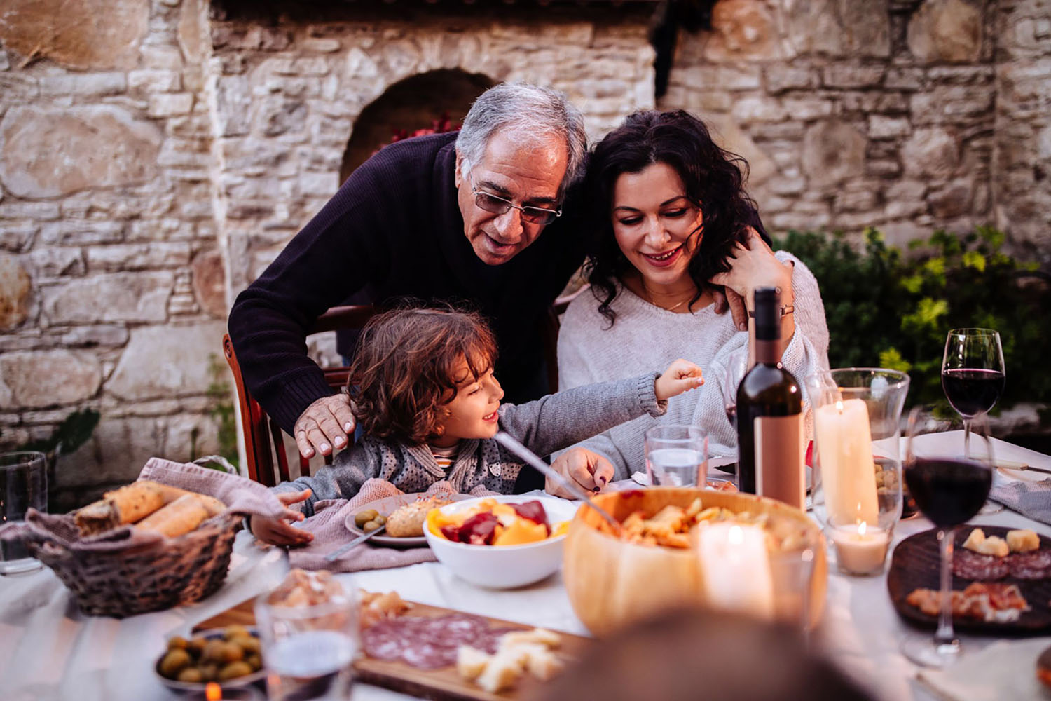 A family having Italian lunch at traditional rustic restaurant in Italian village